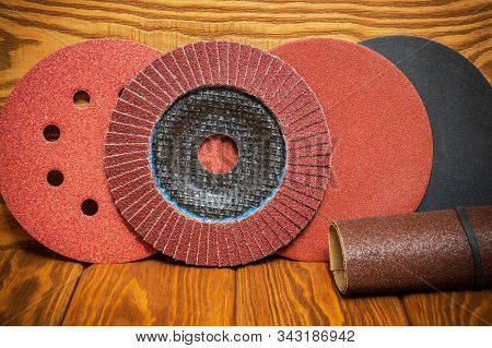 Set of abrasive tools and sandpaper on vintage wooden background stock photo
