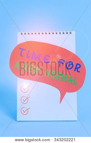 Word writing text Time For A New Normal. Business concept for Make a big dramatic change Replace the expected Standing blank spiral notepad speech bubble lying cool pastel background. stock photo