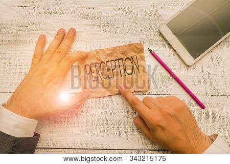 Text sign showing Perception. Conceptual photo individuals organize and interpret their sensory impressions Hand hold note paper near writing equipment and modern smartphone device. stock photo