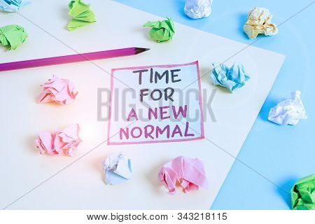Word writing text Time For A New Normal. Business concept for Make a big dramatic change Replace the expected Colored crumpled papers empty reminder blue yellow background clothespin. stock photo