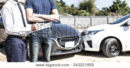 Insurance agents inspect for damage to cars that collide on the road to claim compensation from driving accidents, Insurance concept. stock photo