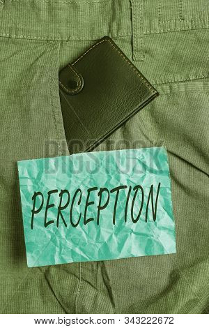 Text sign showing Perception. Conceptual photo individuals organize and interpret their sensory impressions Small little wallet inside man trousers front pocket near notation paper. stock photo