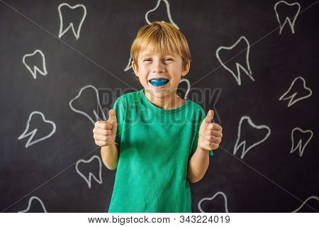 Six-year Old Boy Shows Myofunctional Trainer. Helps Equalize The Growing Teeth And Correct Bite, Dev