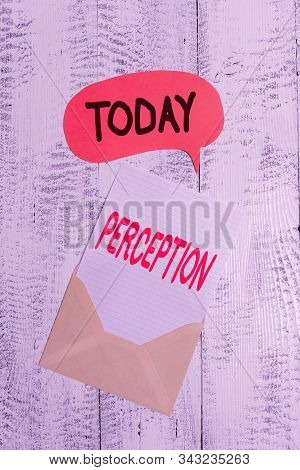 Text sign showing Perception. Conceptual photo individuals organize and interpret their sensory impressions Front view open envelop speech bubble paper sheet lying wooden background. stock photo