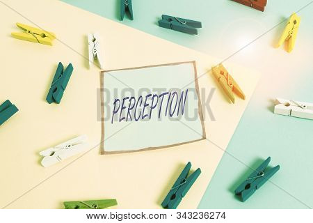 Word writing text Perception. Business concept for individuals organize and interpret their sensory impressions Colored clothespin paper empty reminder yellow blue floor background office. stock photo