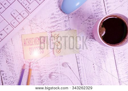 Conceptual hand writing showing Achievement Success. Business photo text status of having achieved and accomplished an aim Writing equipment and computer stuff plus drinks on wooden table. stock photo