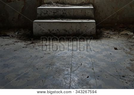 Dusty steps and dirty tiled floor in abandoned interior. stock photo