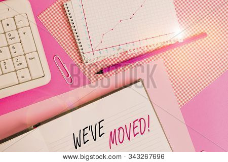 Text sign showing We Ve Moved. Conceptual photo having strong feelings sadness or sympathy has said or done Writing equipments and computer stuffs placed above colored plain table. stock photo
