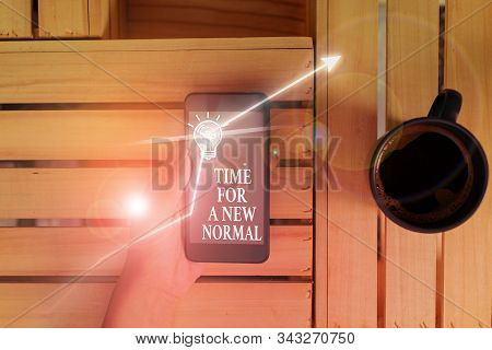 Conceptual hand writing showing Time For A New Normal. Business photo text Make a big dramatic change Replace the expected. stock photo