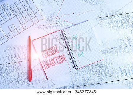 Conceptual hand writing showing Cerebral Infarction. Business photo showcasing focal brain necrosis due to complete and long ischemia Papercraft desk square spiral notebook office study supplies. stock photo