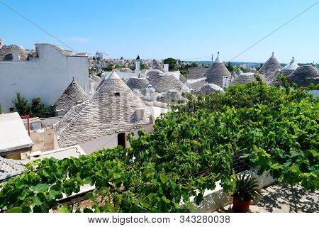 Cityscape over the traditional rock roofs of the traditional Trulli houses in the streets of Alberobello city, Italy, Apulia region, Adriatic Sea stock photo