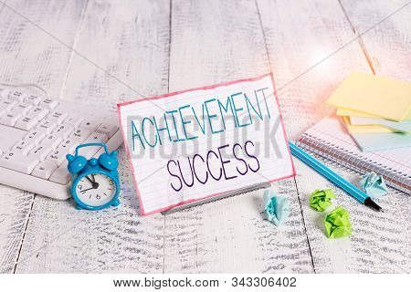 Word writing text Achievement Success. Business concept for status of having achieved and accomplished an aim Notepaper stand on buffer wire in between computer keyboard and math sheets. stock photo