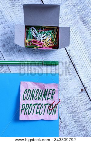 Conceptual hand writing showing Consumer Protection. Business photo text regulation that aim to protect the rights of consumers Wrinkle paper and cardboard placed above wooden background. stock photo