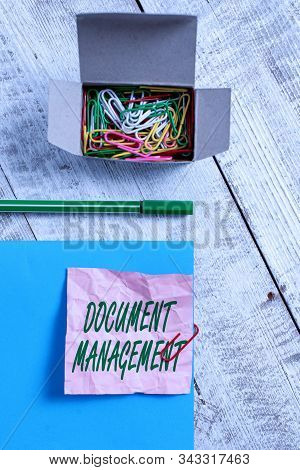 Conceptual hand writing showing Document Management. Business photo text Computerized analysisagement of electronic documents Wrinkle paper and cardboard placed above wooden background. stock photo