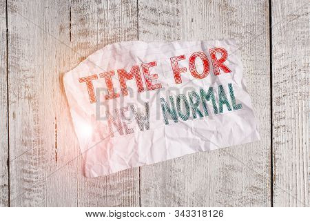 Text sign showing Time For A New Normal. Conceptual photo Make a big dramatic change Replace the expected Crumpled torn paper half broken placed above classic wooden background. stock photo