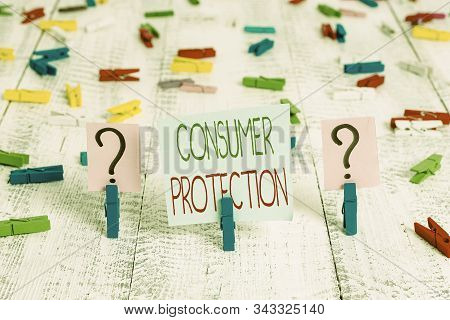 Text sign showing Consumer Protection. Conceptual photo regulation that aim to protect the rights of consumers Scribbled and crumbling sheet with paper clips placed on the wooden table. stock photo