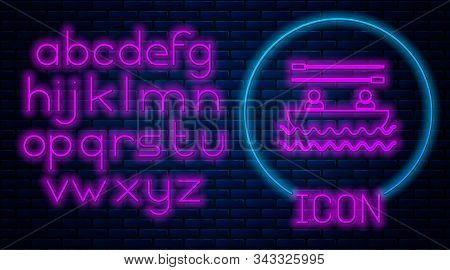 Glowing neon Boat with oars and people icon isolated on brick wall background. Water sports, extreme sports, holiday, vacation, team building. Neon light alphabet. Vector Illustration stock photo