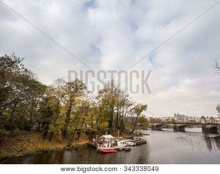 Panorama of the Old Town of Prague, Czech Republic, with focus Prague Castle (Prazsky hrad) seen from the Vltava river in autumn. The castle is the main touristic landmark of the city. stock photo