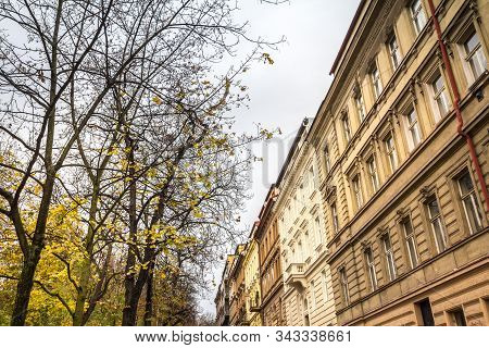 Facades in a typical street of Zizkov district in autumn, during a cloudy afternoon, with its traditional austro hungarian architecture and residential buildings. stock photo