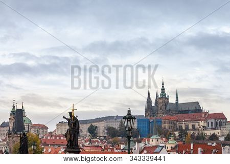 Panorama of the Old Town of Prague, Czech Republic, with a focus on Hradcany hill and the Prague Castle with the St Vitus Cathedral (Prazsky hill) seen from the Vltava river. It is the main landmark of the city. stock photo