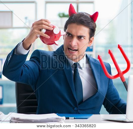 Devil angry businessman in the office stock photo