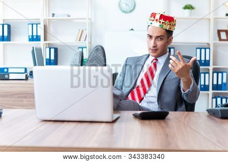 King businessman at his workplace stock photo