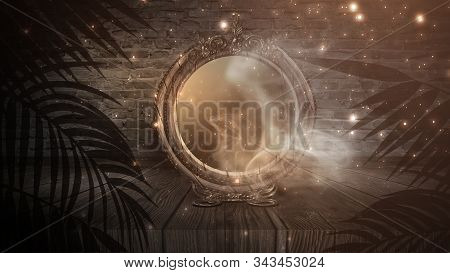 Dark night magic scene. Magic old mirror in a metal frame on a wooden tabletop. Smoke, magic, magical experience, a fabulous night. Blue neon, moonlight at night. stock photo