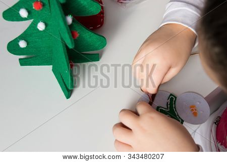 The Hand Of The Child Make Snowman And Christmas Tree With Needle, Thread For Christmas Greeting Car