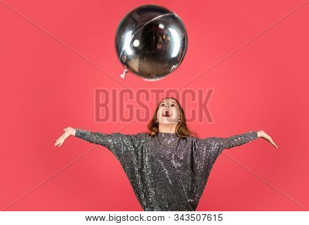 Enjoying special day. Happy girl play with helium balloon. Small child celebrate with holiday look. Holiday party. Holiday celebration. Birthday anniversary. Creating holiday mood with air balloon stock photo