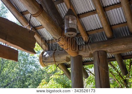 Ceiling of jungle-themed hut constructed with logs and rope stock photo