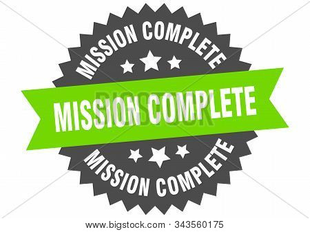 mission complete sign. mission complete green-black circular band label stock photo