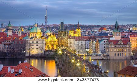 Prague, Czech Republic. Aerial panoramic cityscape image of Prague with famous Charles Bridge during winter sunset. stock photo