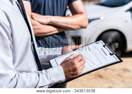 Insurance Agent examining car crash and customer assessed negotiation, checking and signing on report claim form process after accident collision, Accident and insurance concept. stock photo