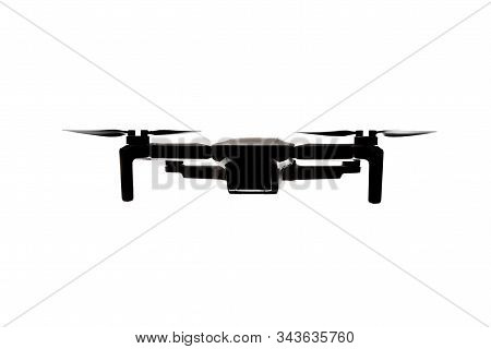 Modern drone silhouette flying in the air - view from the front. Surveillance or areal capturing element for your mockups stock photo
