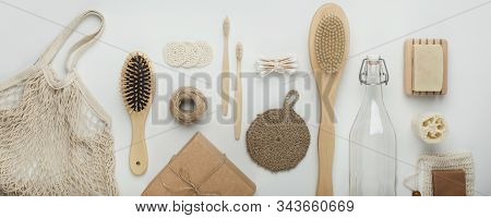 Zero waste flat lay. Eco bamboo accessories for bath care and reusable items on white background, wide panorama stock photo