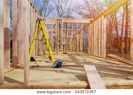 Framing beam of new house under construction interior with wood framing beam stock photo