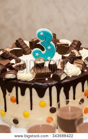 Chocolate birthday cake for a third birthday or anniversary celebration. Number three birthday stock photo