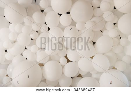 background of many white balloons, many white balloons of different sizes. stock photo