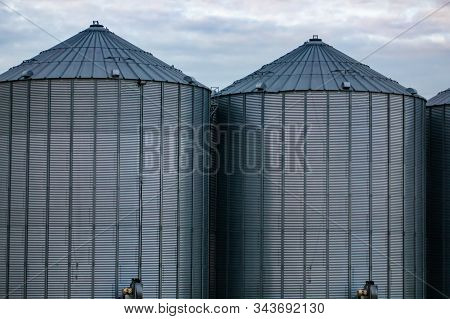 Details of two symmetrical bulk grain and rice storage silos at an industrial agrarian facility. Farming and agriculture in Saskatchewan, Canada stock photo