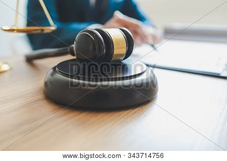 Lawsuit and justice concept, Lawyer  working with partner at law firm. legal consulting discussion defendant punishment law in courtroom. stock photo