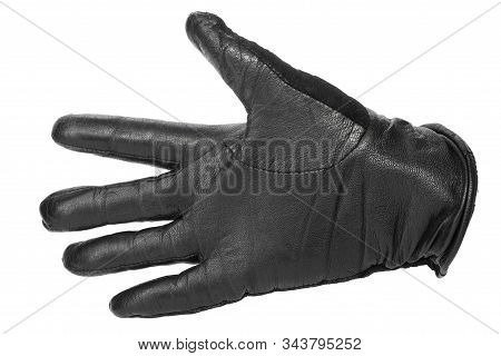 hand in a black leather glove with fingers apart. isolated on white background stock photo