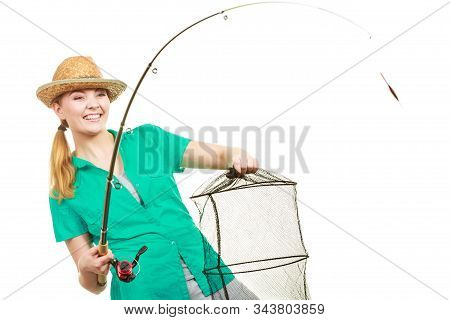 Fishery, spinning equipment, angling sport and activity concept. Happy smiling woman with fishing rod and net. stock photo