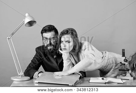 Man of style and status. secretary with boss at workplace. sexy woman and man work in office at laptop. business couple at computer. corporate ethics. businessman and assistant. love affair at works stock photo