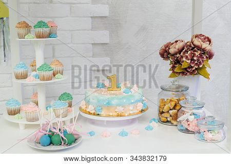 Candy bar with cake, cup cakes and cake pops on a light background. Green, blue, pink colors. stock photo