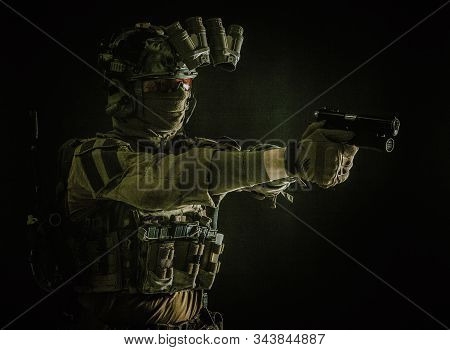 Counter terrorist squad fighter soldier aiming pistol stock photo