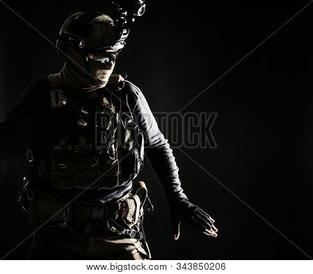 Army infantryman moving in darkness with caution stock photo