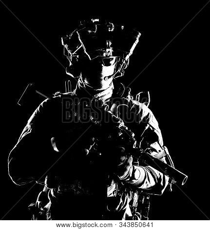 Modern army elite forces shooter in darkness stock photo