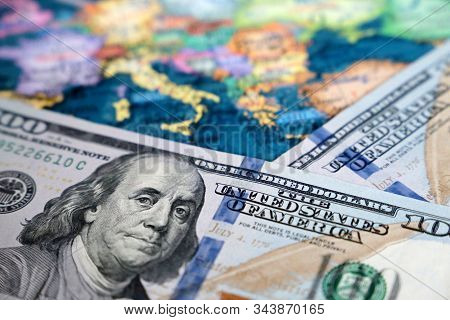 US dollars on the map of Europe. Concept of trade between the United States and Europe, exchange rate, tourism, american investment in EU stock photo