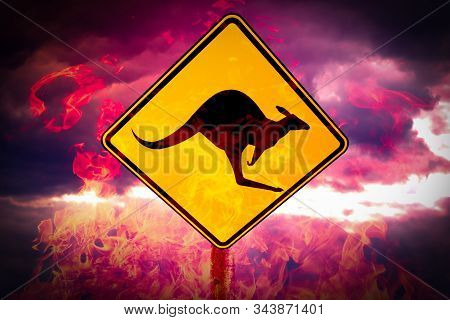 Australian fires catching kangaroo crossing sign against the gloomy dark sly. Forest fires in Australia concept. stock photo