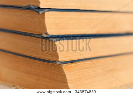 stack of old book education concept background, many books piles with copy space for text stock photo
